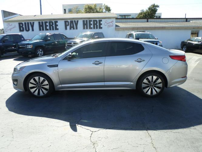 2013 Kia Optima SX (5XXGR4A60DG) with an 2.0L L4 DOHC 16V TURBO engine, 6-Speed Automatic transmission, located at 6112 N Florida Avenue, Tampa, FL, 33604, (888) 521-5131, 27.954929, -82.459534 - Photo #0