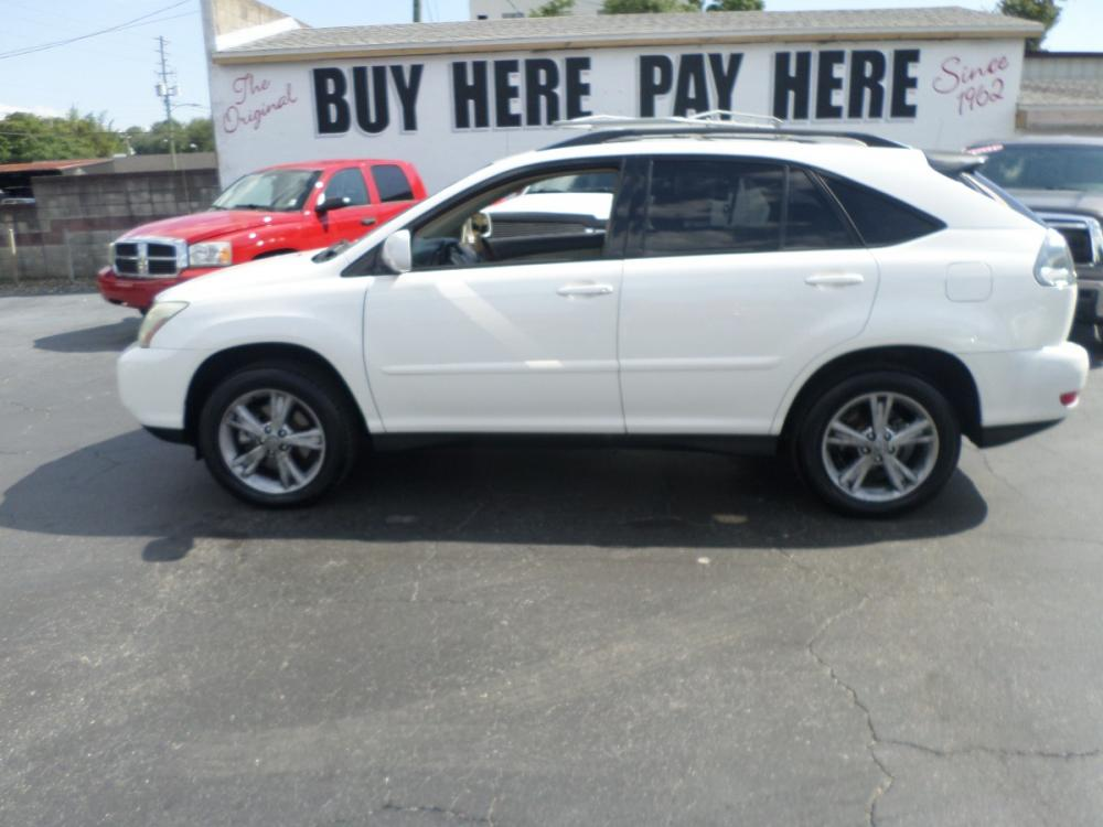 2006 Lexus RX 400h FWD (JTJGW31U360) with an 3.3L V6 DOHC 24V HYBRID engine, Automatic CVT Overdrive transmission, located at 6112 N Florida Avenue, Tampa, FL, 33604, (888) 521-5131, 27.954929, -82.459534 - Photo #0